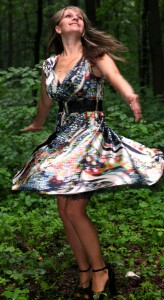 a young Catholic woman wearing a colorful dress in a forest in June 2013, portrait 3/9