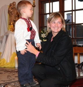 a young pretty woman with her son in a Catholic Church