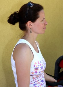 an amazingly beautiful brunette Catholic woman near a church in May 2013, picture 1 out of 6