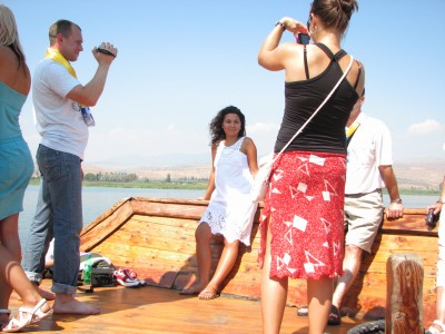 Christian pilgrims taking photos on a boat on the Galilean Sea (Lake) in Israel (where Jesus Christ preached), picture 11