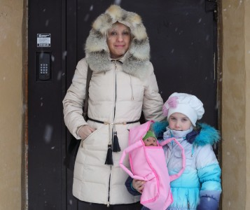 a mother with her daughter going out in winter