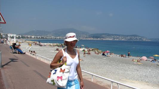 Woman walking on the Promenade des Anglais in Nice, France