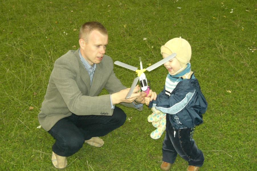Father, son and a toy helicopter
