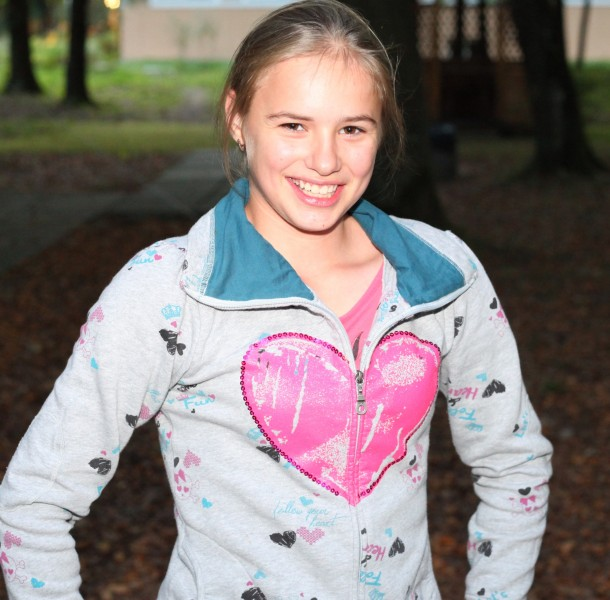 a sweet beautiful appealing smiling Catholic girl in a park, picture 24
