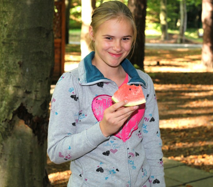 a beautiful appealing smiling Catholic girl eating water-melon, photo 25
