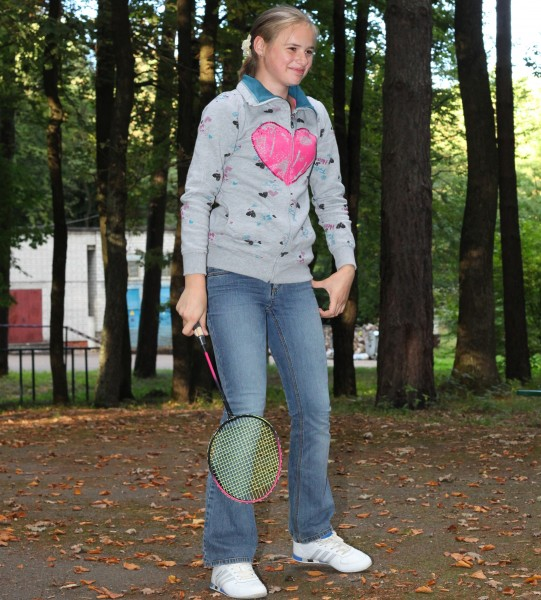 a beautiful appealing smiling Catholic girl playing badminton, photo 27
