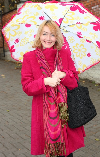 a beautiful Catholic woman with an umbrella, picture 2
