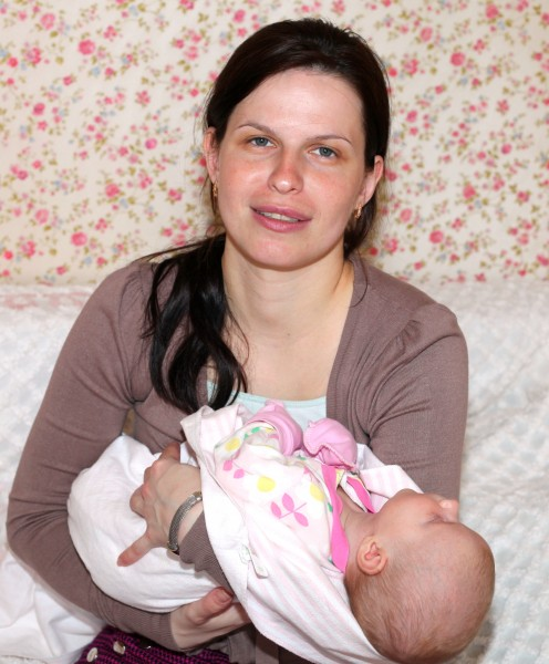 a beautiful brunette Catholic woman with her baby daughter, picture 1