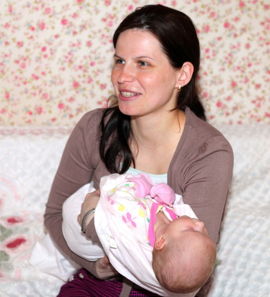 a beautiful brunette Catholic woman with her baby daughter, picture 3