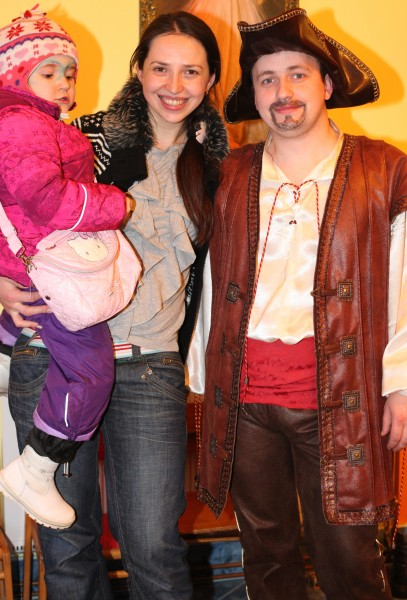 a beautiful brunette Catholic woman with her cute daughter and a man in a Catholic kindergarten, photo 2