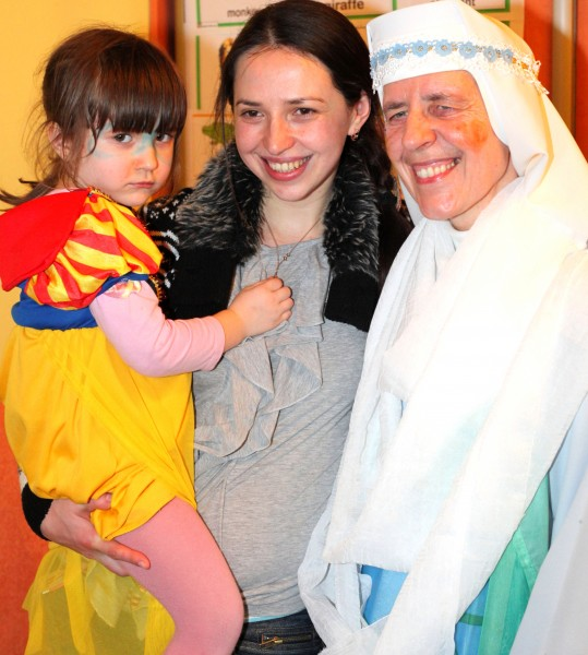 a beautiful brunette Catholic woman with her cute daughter and a nun in a Catholic kindergarten, photo 1