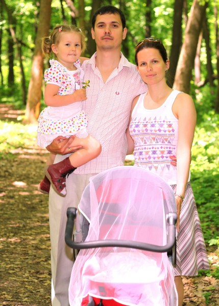 a beautiful Catholic family in a forest in May 2013