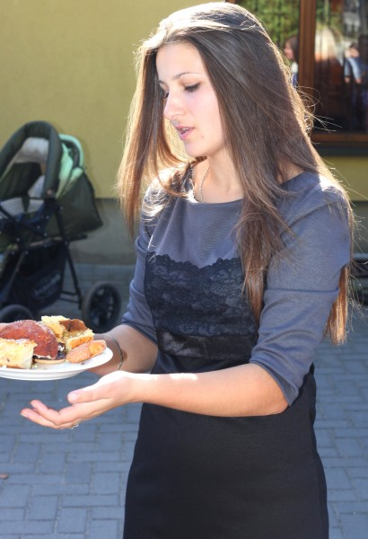 a beautiful brunette Catholic girl with sweets near a Church, photo 32