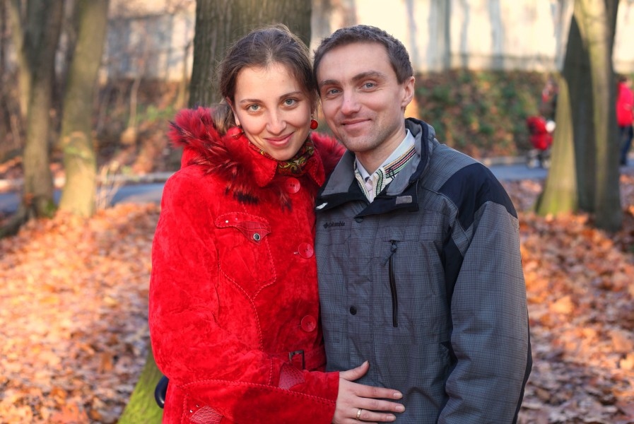 a beautiful Catholic wife with her husband in a park, photo 3