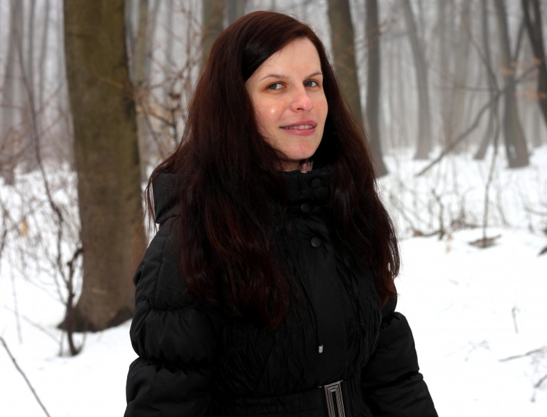an amazingly beautiful charming Catholic woman in a forest, picture 17