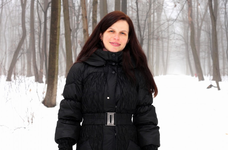 an amazingly beautiful charming Catholic woman in a forest, picture 3