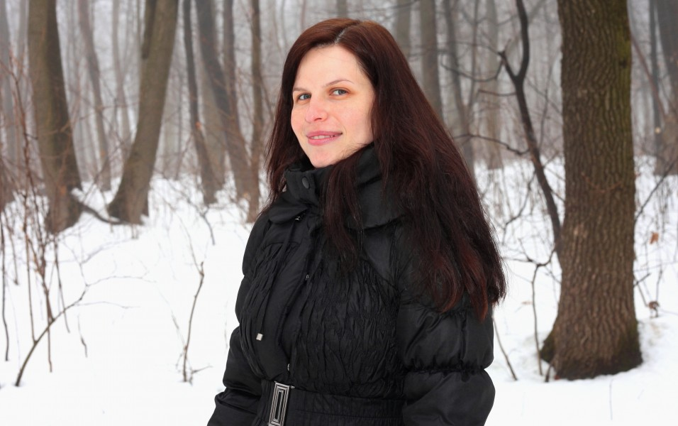 an amazingly beautiful charming Catholic woman in a forest, picture 4