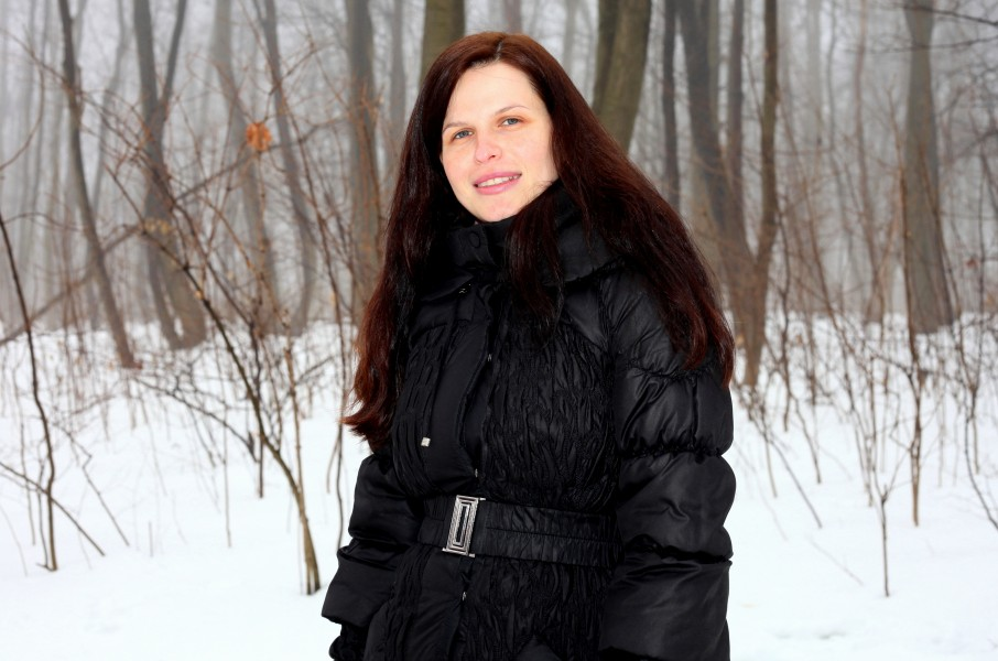 an amazingly beautiful charming Catholic woman in a forest, picture 5