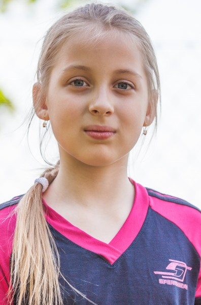a blond Catholic cutie photographed in May 2014, portrait 3/10