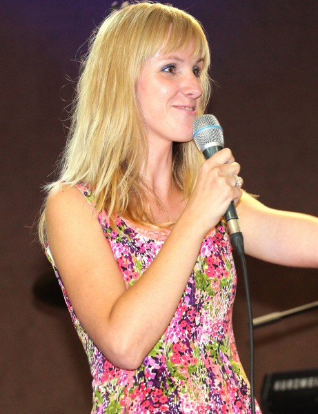 a blond girl at a stage at a protestant gathering in July 2013, image 2/7