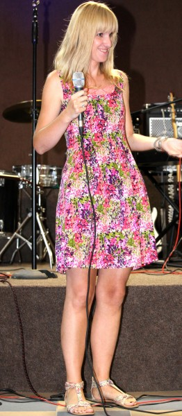 a smiling girl in a colorful dress at a protestant gathering in July 2013, image 3/7