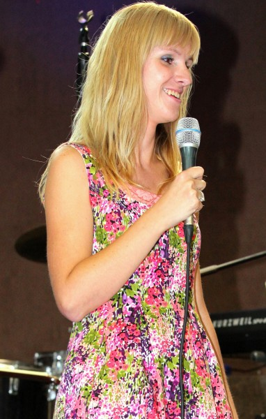 a blond girl with a microphone in July 2013, image 5/7