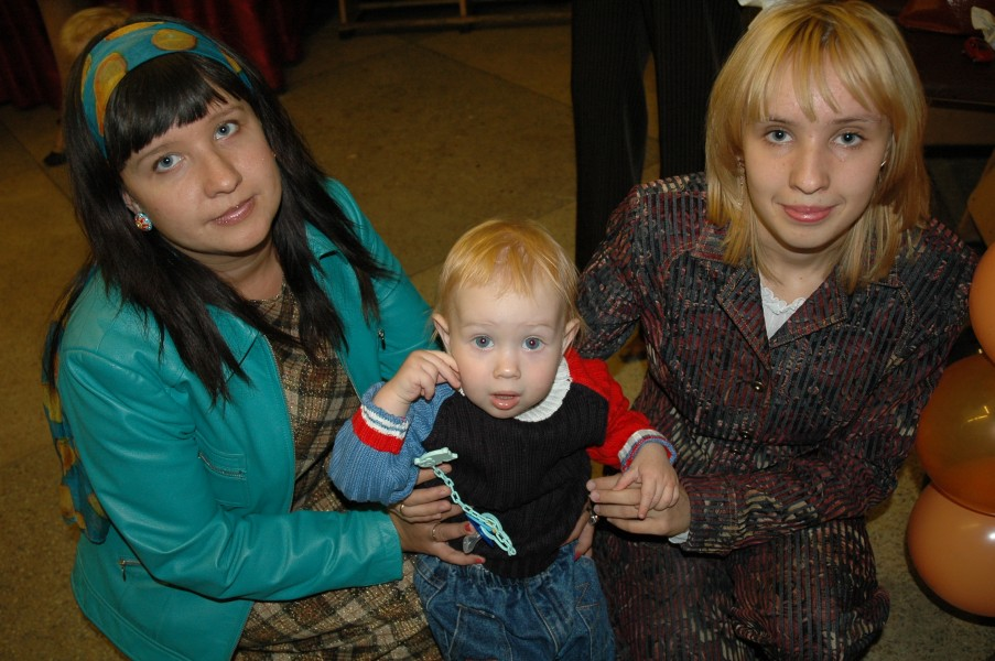 A baby boy with mom and aunt