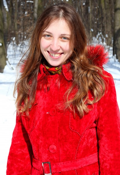 a charming beautiful attractive young Catholic woman in a snowy forest, photo 4