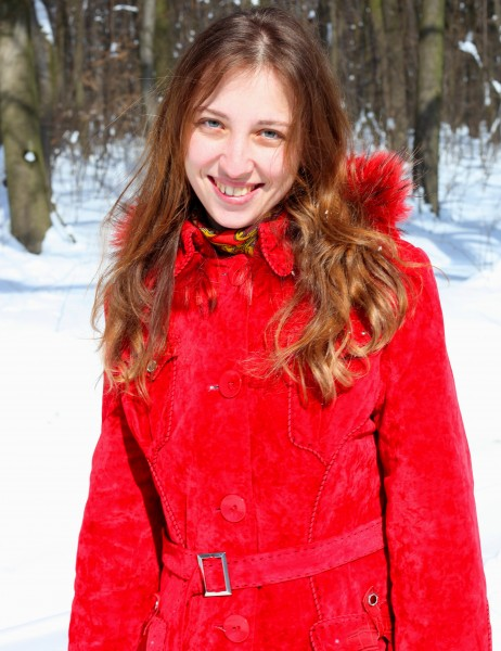 a charming beautiful attractive young Catholic woman in a snowy forest, photo 5