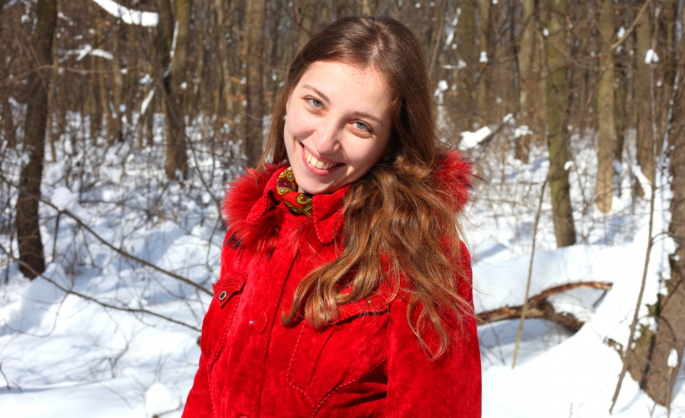 a charming beautiful attractive young Catholic woman in a snowy forest, photo 6