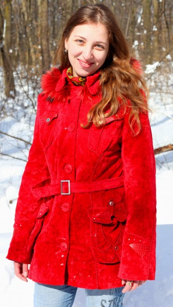 a charming beautiful attractive young Catholic woman in a snowy forest, photo 7