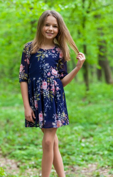 a cute 12-year-old girl photographed in May 2015, picture 1