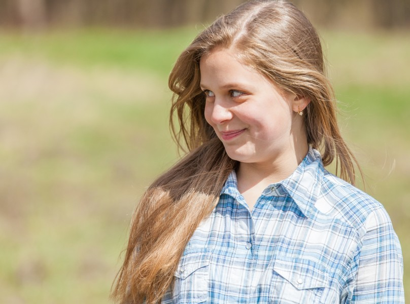 a cute blond 12-year-old girl photographed in April 2015, picture 5