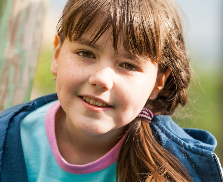 a cute brunette Catholic child girl photographed in May 2014, picture 2/5