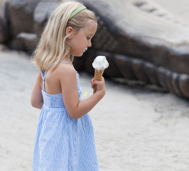 a fair-haired child girl eating ice-cream in Copenhagen, Denmark, in June 2014, picture 31