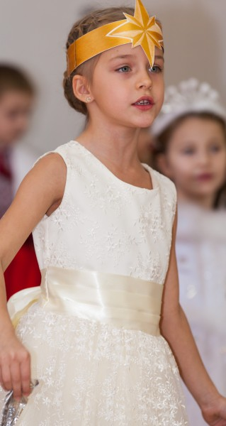 a cute young girl performing in school in December 2013, picture 7/14