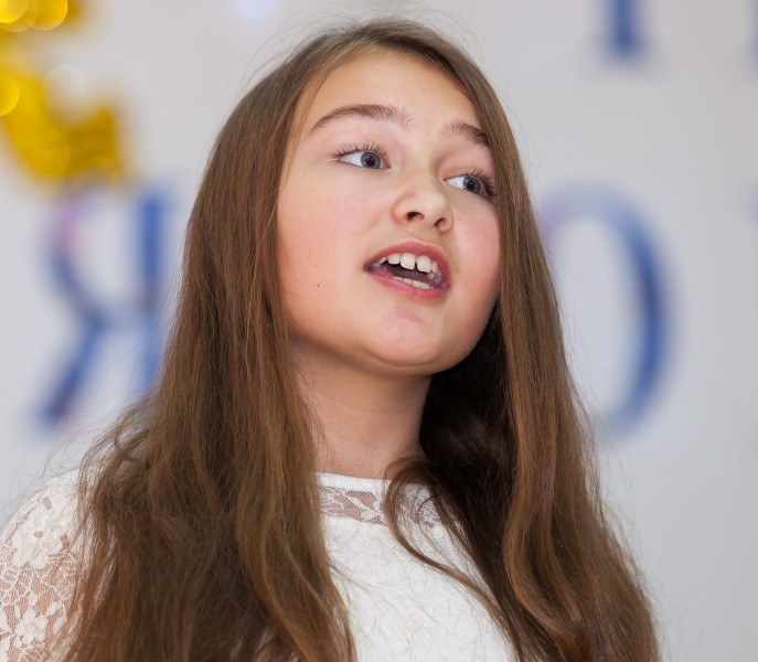 a cute young girl performing in school in December 2013, picture 11/14