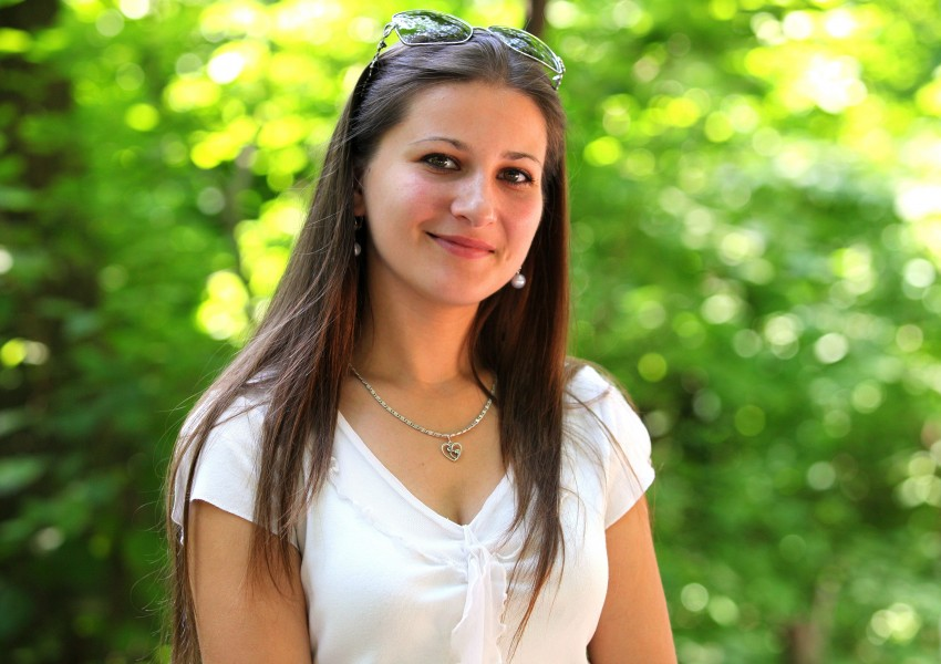 a smiling pretty brunette girl (Catholic), photographed in July 2013, picture 9/22