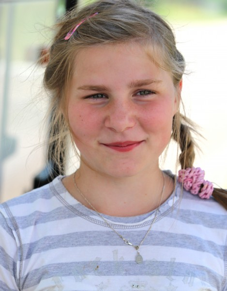 a young blond Catholic girl in a Catholic camp in July 2013, girl 4/4