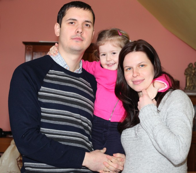a beautiful brunette pregnant Catholic woman with her husband and daughter, picture 9