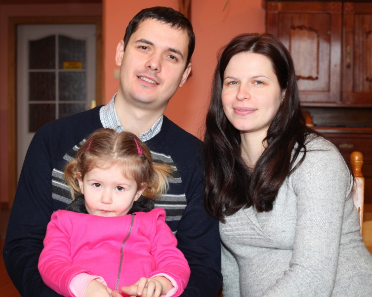a pregnant beautiful brunette Catholic woman with her husband and daughter, picture 14