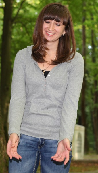a beautiful charming cute brunette Catholic girl in nature