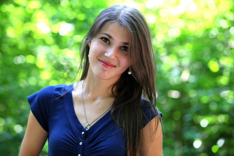 a smiling beautiful brunette girl (a Catholic Christian) photographed in July 2013, portrait 5/15