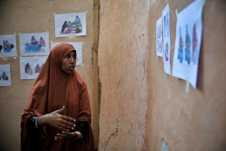 A woman at the Mother and Child Health Center teaches other women about post natal care during a visit to the hospital in Mogadishu, Somalia, by the Special Representative of the Secretary-General on (8621608162)