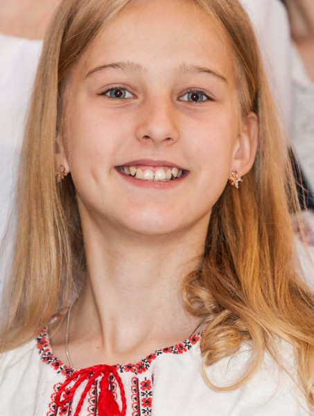 a young blond girl photographed in a Catholic church in May 2014, picture 2/2