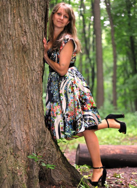a young Catholic woman wearing a colorful dress in a forest in June 2013, portrait 1/9