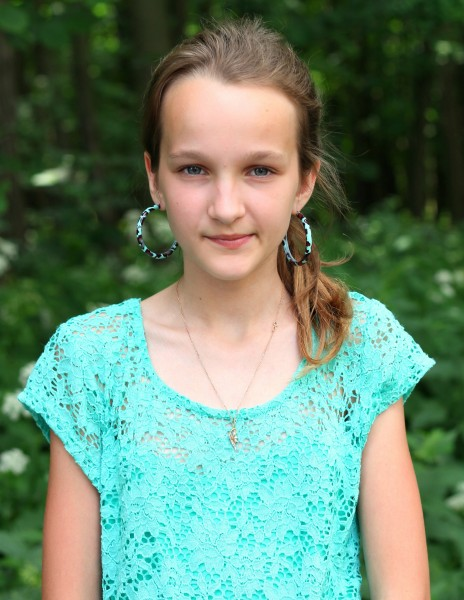 a really beautiful girl with huge earrings, photographed in June 2013, portrait 11/27