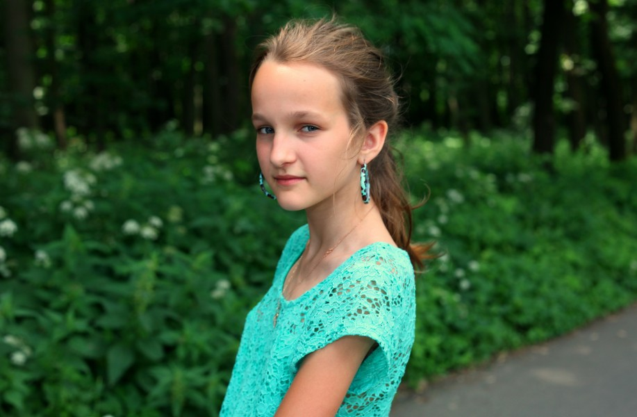 an absolutely beautiful Catholic girl with huge earrings, photographed in June 2013, portrait 27/27