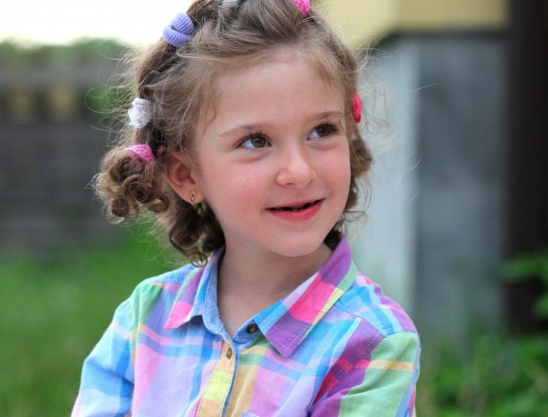 a smiling cute sweet brunette child girl in a Catholic camp Vacations with God, photographed in July 2013, portrait 6/14