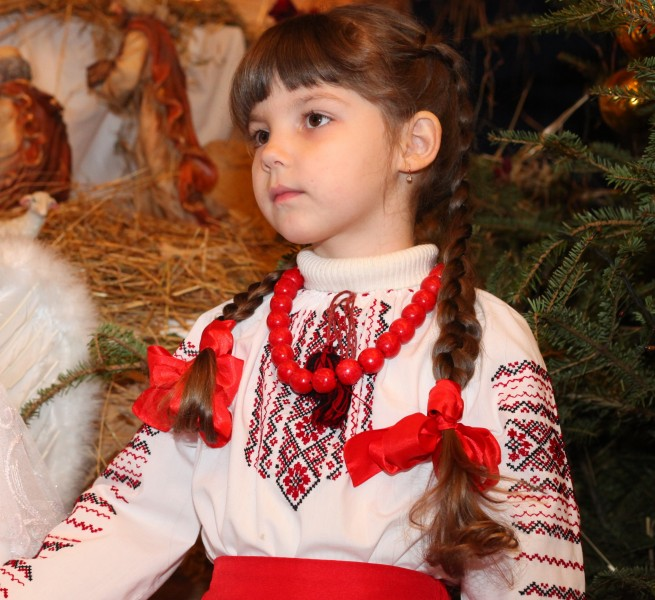 an amazingly beautiful brunette Catholic child girl performing in the Nativity scene, photo 2